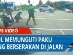 aksi-ojol-memunguti-paku-yang-berserakan-di-jalan-dapat-pujian-netizen.jpg
