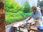 andi-firman-53-seorang-pelukis-mural-disabilitas.jpg