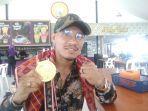 atlet-wushu-peraih-medali-emas-pada-pon-ke-xx-di-papua-brando-mamana.jpg