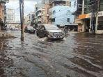 banjir-merendam-jalan-mh-thamrin-kelurahan-pandau-hulu-i-kecamatan-medan-kota-kota-medan.jpg
