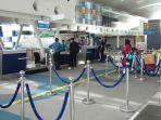 calon-penumpang-melakukan-check-in-di-counter-garuda-indonesia-bandara-kualanamu.jpg