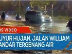 diguyur-hujan-deras-jalan-william-iskandar-tergenang-air-setinggi-betis-qq.jpg