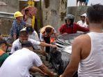 insiden-mobil-tenggelam-setelah-jatuh-dari-kmp-ihan-batak.jpg
