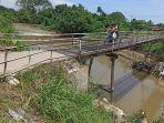jembatan-rawam-ambruk-di-rengas-pulau.jpg