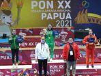 juwita-niza-wasni-terima-medali-emas-wushu-pon-papua.jpg