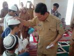 kepala-dinas-kesehatan-provinsi-sumatera-utara-dr-alwi-mujahit-hasibuan.jpg