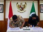 muhammad-bobby-afif-nasution-dan-rektor-universitas-sumatera-utara-usu-muryanto-amin.jpg