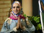 mulan-jameela-saat-mengenakan-hijab_20180525_233706.jpg