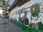 mural-yang-mengkampanyekan-protokol-kesehatan-di-jalan-pajak-ikan-lama-medan-dirusak.jpg