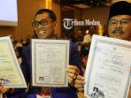 pasangan-bakal-calon-gubernur-dan-wakil-gubernur-sumut-jr-ance-menunjukkan-ijazah_20180315_205227.jpg