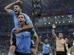 pemain-uruguay-luis-suarez-atas-dan-diego-godin-melakukan-selebrasi_20180706_175936.jpg