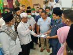 penyampaian-aspirasi-mui-langkat-dan-ormas-islam-lainnya-diterima-puluhan-anggota-dprd-langkat.jpg