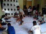 proses-pelipatan-surat-suara-di-gudang-kpu-kabupaten-samosir.jpg
