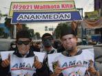 relawan-akhyar-salman-saat-melakukan-kampanye-damai.jpg