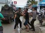 seorang-prajurit-tni-dan-dua-anggota-polisi-terlibat-baku-pukul.jpg