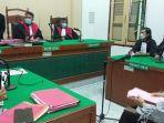 terdakwa-novalia-rudiyan-saat-mengikuti-sidang-di-pengadilan-negeri.jpg