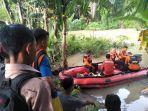 tim-sar-gabungan-saat-melakukan-pencarian-terhadap-korban-hilang-di-sungai-kualanamu.jpg