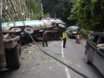 truk-bermuatan-cpo-minyak-mentah-mengalami-kecelakaan-tunggal-di-jalan-jamin-ginting_20181020_180032.jpg