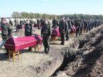 wali-kota-di-ukraina-gali-600-kuburan.jpg