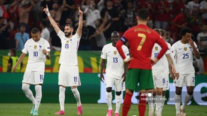 Pemain depan Prancis Karim Benzema merayakan mencetak gol kedua tim selama pertandingan sepak bola Grup F UEFA EURO 2020 antara Portugal dan Prancis di Puskas Arena di Budapest pada 23 Juni 2021.