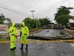 jalan-trans-kalimantan-di-mataraman-kabupaten-banjar-putus-setelah-banjir-pada-kamis-1412021.jpg