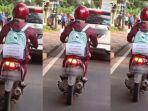 kreatifitas-seorang-ibu-hamil-saat-berkendara-sepeda-motor-sendirian.jpg
