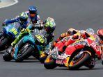 marc-marquez-and-valentino-rossi-in-action.jpg