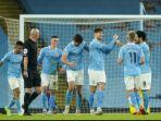 momen-pemain-manchester-city-merayakan-gol.jpg