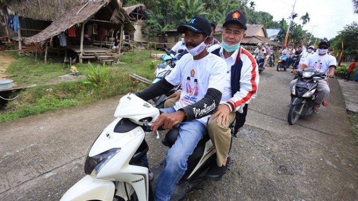 Kunjungi Mentawai, Nasrul Abit Diarak Naik Motor Keliling Siberut Selatan