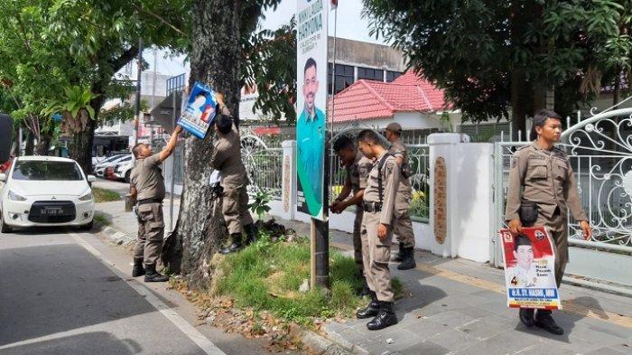 Satpol PP Padang Turunkan Ribuan Alat Peraga Kampanye Caleg yang Terpasang di Tempat Terlarang