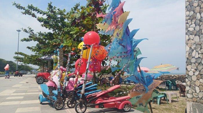 Ajak Anak-anak Liburan ke Pantai Padang, Ada Ragam Permainan, Mobil-mobilan hingga Skuter