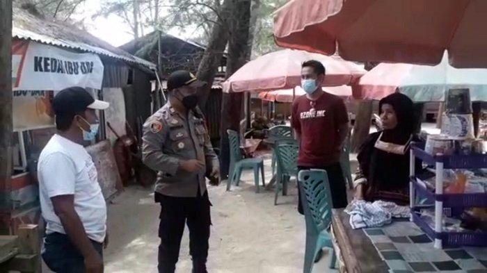 Aparat Polsek Padang Selatan Sasar Keramaian, Tegur Warga yang Tidak Pakai Masker Saat Liburan