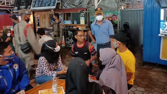 Kedapatan Tak Pakai Masker di Pusat Keramaian, 14 Warga Padang Disanksi Push Up dan Menyapu
