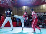 atlet-tarung-drajat-sumbar-yogi-pratama-saat-bertanding-di-pon-papua-2021-jumat-78102021.jpg