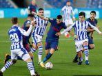 atletico-yannick-ferreira-carrasco-tengah-berduel-dengan-pemain-real-sociedad-d.jpg
