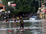 banjir-melumpuhkan-akses-jalan-kartini_20200102_211111.jpg