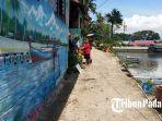 lukisan-atau-mural-yang-berada-di-dinding-rumah-warga-dekat-gerbang-gunung-padang.jpg