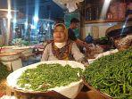 pedagang-cabai-rawit-di-pasar-raya-padang-kamis-1132021.jpg