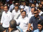 presiden-joko-widodo-berjalan-bersama-calon-presiden-prabowo-subianto-usai-mencoba-kereta-mrt.jpg