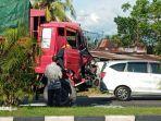 satu-unit-truk-rusak-pada-bagian-depannya-di-jalan-by-pass-taruko.jpg