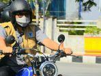 wali-kota-padang-hendri-septa-menggunakan-sepeda-motor-meninjau.jpg