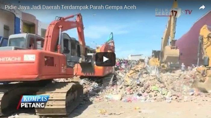 VIDEO : Alat Berat Menggali Puing-puing untuk Mencari Korban Gempa