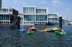 SinggahiWaterbuurt,RumahApungdiNegeri Kincir Angin Belanda