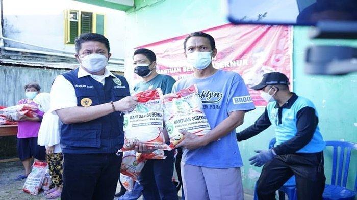 HD Gandeng HMI Kota Palembang Salurkan Beras Bagi Masyarakat Sumsel yang Terdampak Pandemi Covid-19
