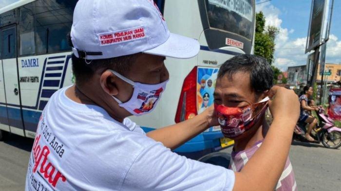 Momen HUT Ke-75 Kemerdekaan RI, KPU Musirawas Sosialisasi Pemilihan Serentak Bagikan Masker Massal