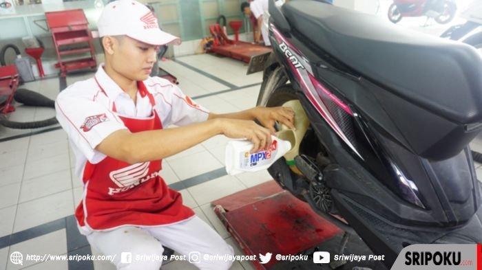 Honda BeAT 2020 Hanya Butuh Oli 650 ml, Bisakah Sisanya Disimpan?