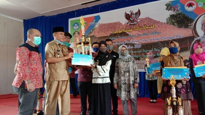 Henny Guru Muda Dari Payaraman OI Juara I Lomba Karya Tulis Ilmiah, Koleksi Museum Sumatera Selatan