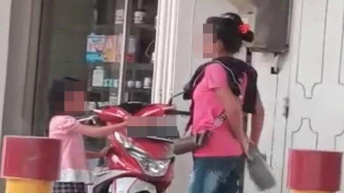 Identitas Wanita Baju Pink yang Terekam Video Aniaya Bocah di Lampu Merah Charitas, Videonya Viral