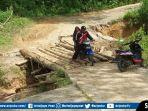 akses-jalan-yang-berhasil-diperbaiki-oleh-warga-setempat.jpg