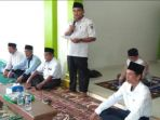 camat-sukakarya-m-setiawan-memberikan-kata-sambutan-saat-kegiatan-pembinaan-102-guru-ngaji_20181108_113425.jpg